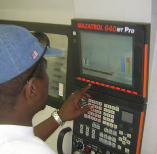 Kevin Green programming the controller of the Mazak machining center to fabricate a part.