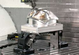 The Kurt 5-axis clamping system allowsfor the larger head clearance required on large5-axis machines.Photo courtesy of Kurt Manufacturing Company.