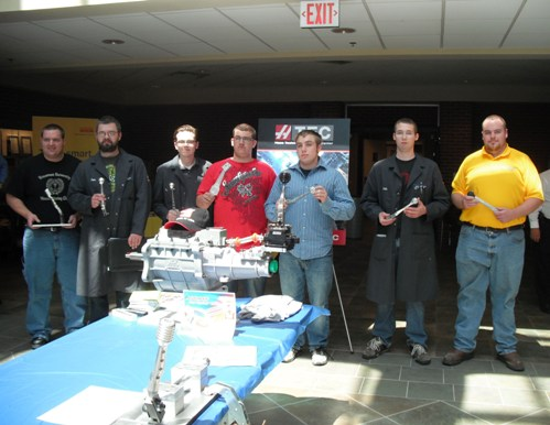 Students from Vincennes University's Advanced Manufacturing Program pose with their winning projects