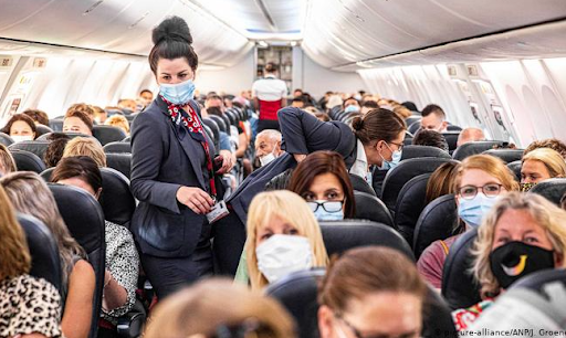 people on a plane wear masks during the pandemic